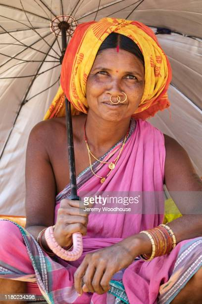portrait of a woman with an umbrella - jeremy woodhouse stock pictures, royalty-free photos & images