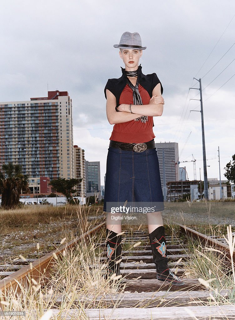 Portrait of a Woman With Attitude in Individual Clothing Standing on an Abandoned Rail Track : Stock Photo