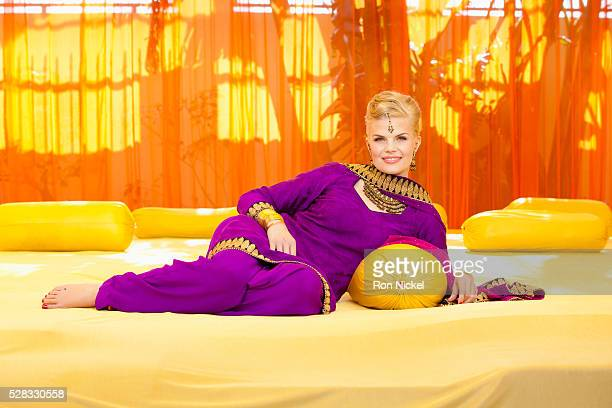 Portrait of a woman with blond hair wearing a purple sari; ludhiana punjab india