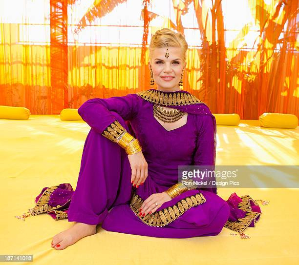 Portrait Of A Woman With Blond Hair Wearing A Purple Sari