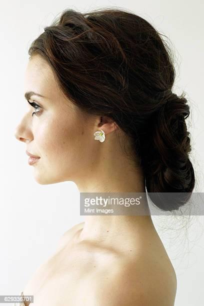 portrait of a woman with brown hair tied in an elegant bun. - cola de caballo cabello recogido fotografías e imágenes de stock
