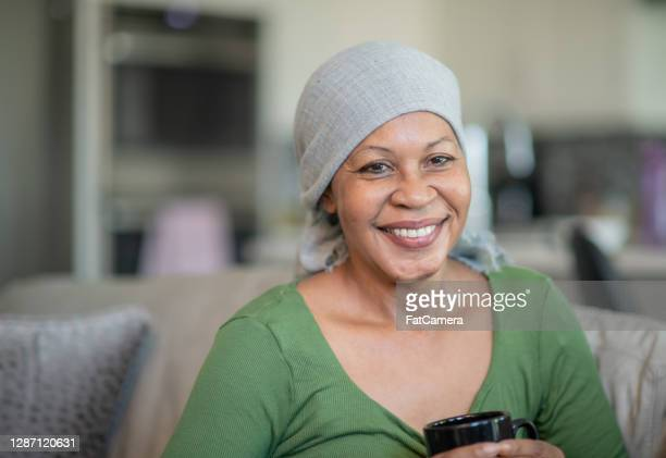 portrait of a woman with cancer - headwear stock pictures, royalty-free photos & images