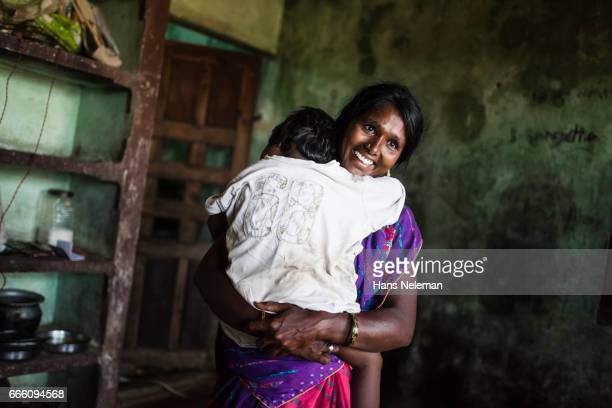portrait of a woman with child - tamil nadu stock pictures, royalty-free photos & images