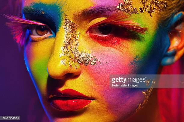 portrait of a woman with colorful body painting