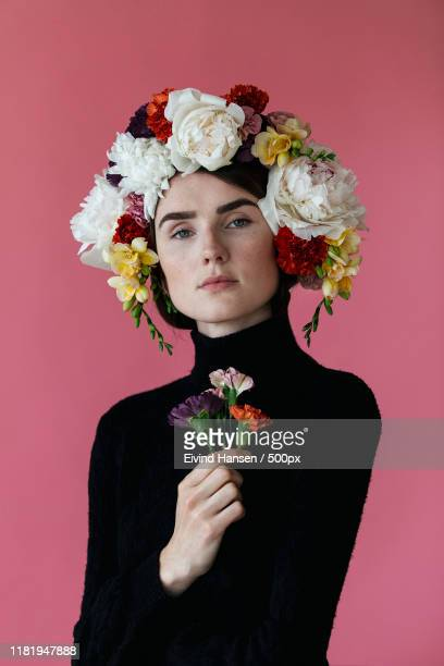 portrait of a woman with floral headdress - headwear stock pictures, royalty-free photos & images