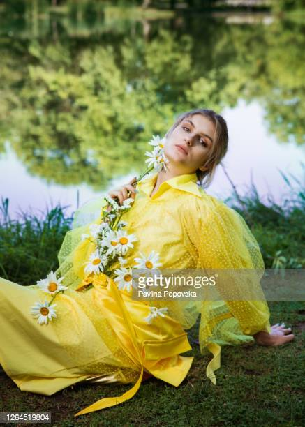 portrait of a woman with flowers - editorial stock pictures, royalty-free photos & images