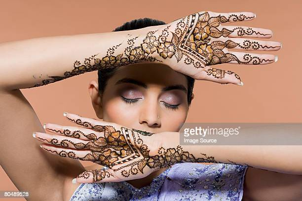Portrait of a woman with henna tattoos on her hands