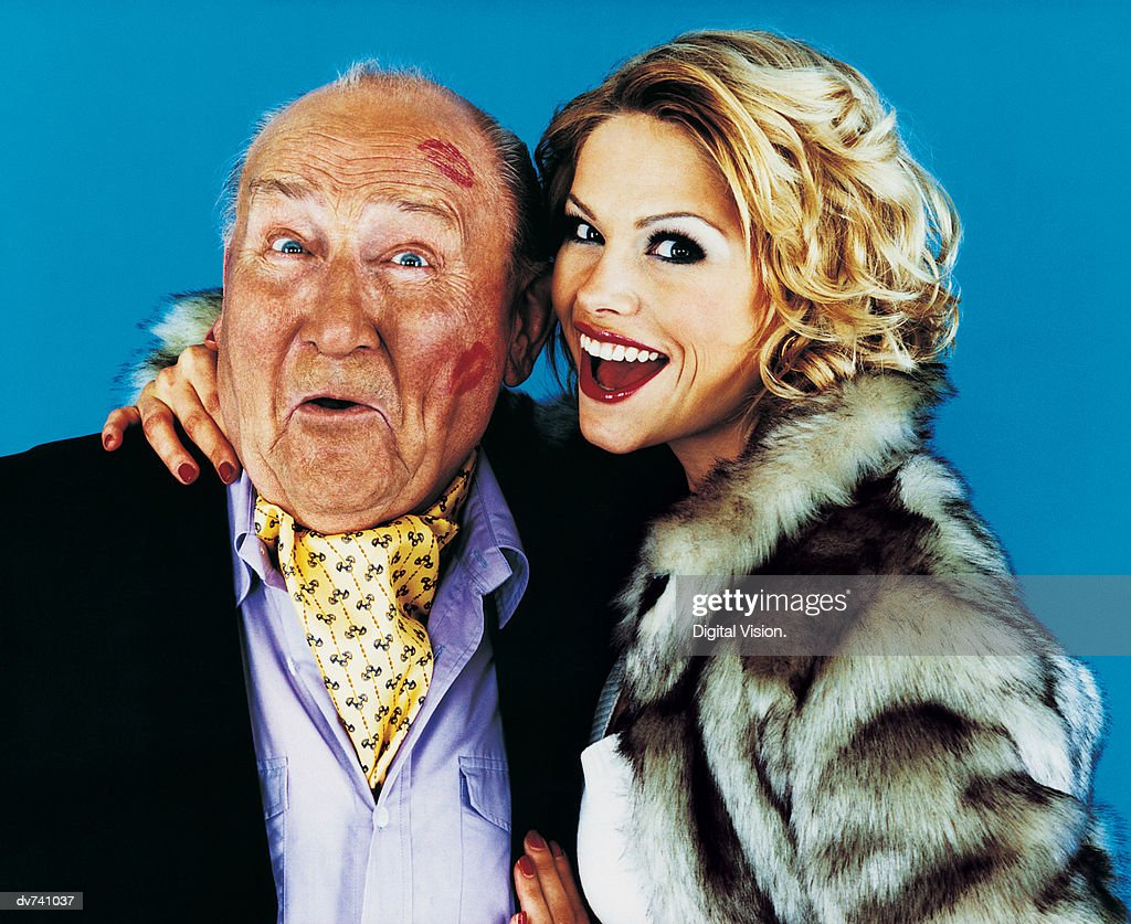 Portrait of a Woman with her Arm Around a Wealthy Senior Man : Stock Photo