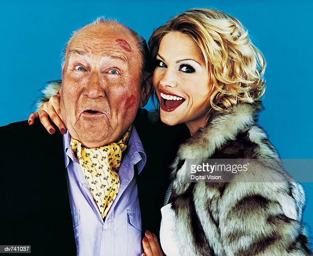 portrait of a woman with her arm around a wealthy senior man - may december romance stock photos and pictures