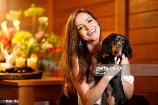 portrait of a woman with her dog at christmas - harlequins stock pictures, royalty-free photos & images