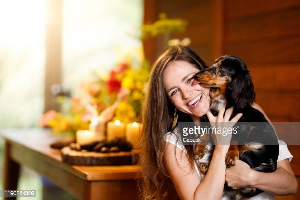 portrait of a woman with her dog at christmas - dachshund christmas stock pictures, royalty-free photos & images