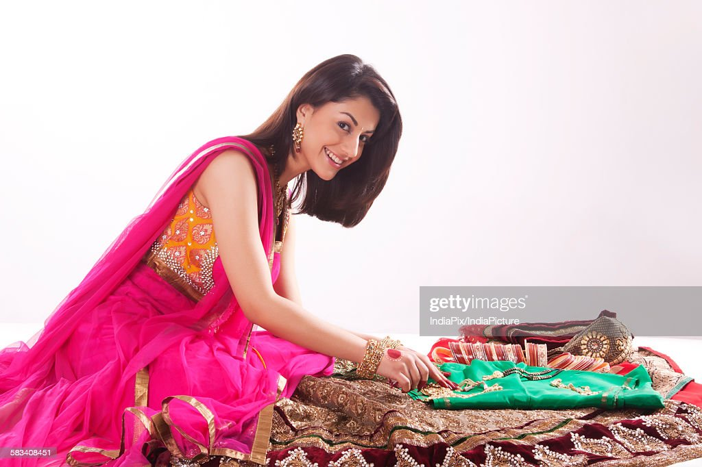Portrait of a woman with jewelery and wedding attire : Stock Photo
