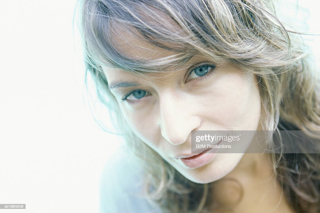 Portrait of a Woman With Long Blond Curly Hair : Stock Photo