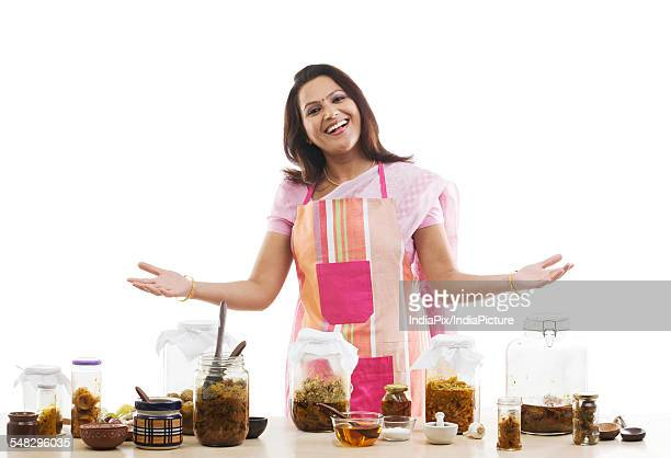 Portrait of a woman with pickle jars