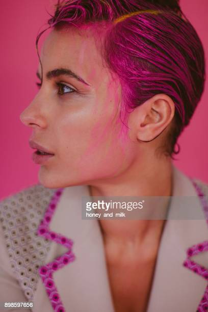 portrait of a woman with pink hair and hair dye running down her face - hair colourant stock pictures, royalty-free photos & images