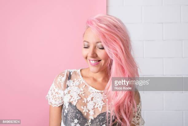 portrait of a woman with pink hair - women in sheer clothes stock photos and pictures