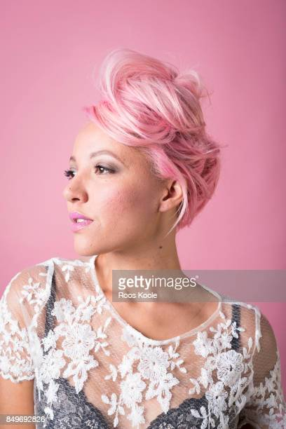 Portrait of a woman with pink hair