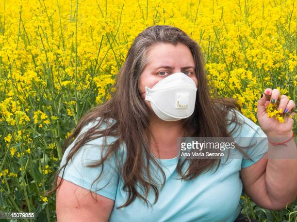 portrait of a woman with pollen allergy - nose mask stock pictures, royalty-free photos & images