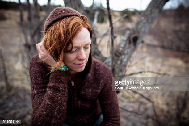 portrait of a woman with red hair looking contemplative - home run ストックフォトと画像