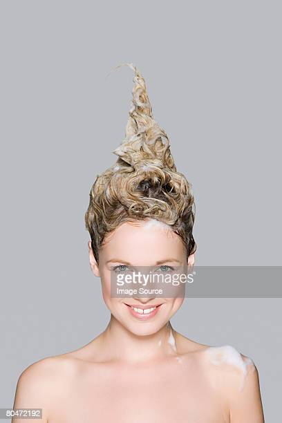 Portrait of a woman with shampoo in her hair