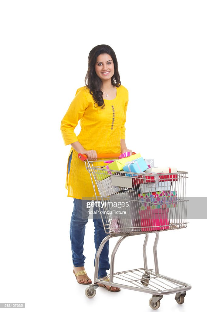 Portrait of a woman with shopping cart : Stock Photo