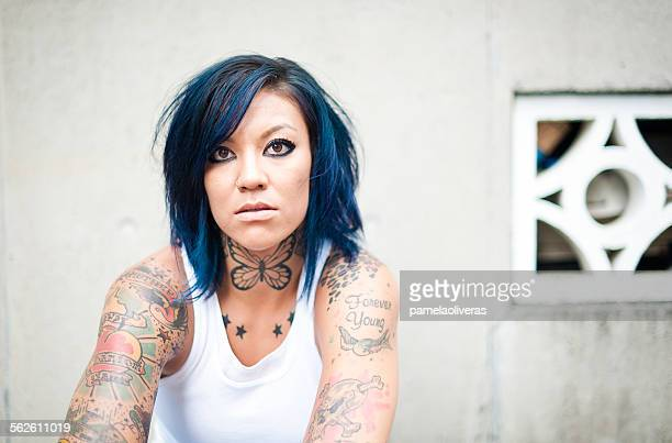Portrait of a woman with tattoos