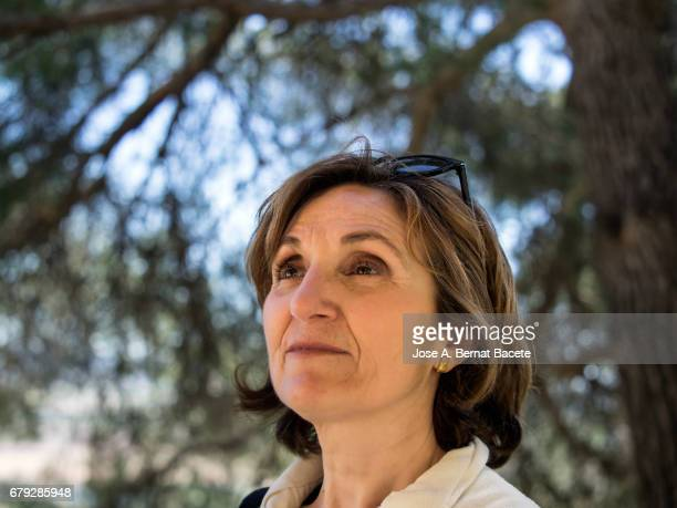 portrait of a woman with the sunglasses on the hair sat in the nature - iberian stock photos and pictures