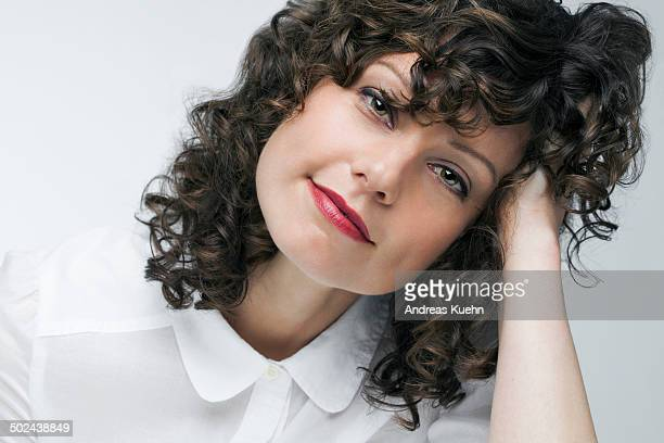 Portrait of a woman with white shirt and red lips.
