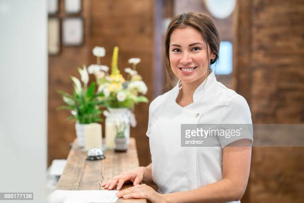 portrait of a woman working at a spa - beauty care occupation stock photos and pictures