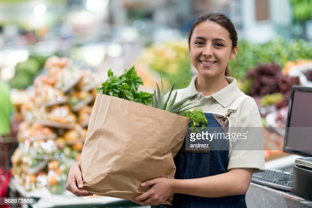 portrait of a woman working at a supermarket - grocery delivery stock pictures, royalty-free photos & images
