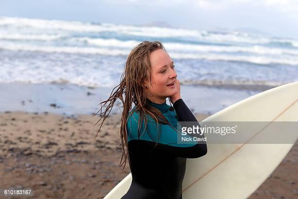 Portrait of a women surfer by the sea