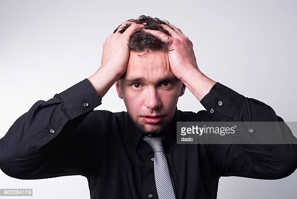 portrait of a worried businessman - pulling hair stock photos and pictures