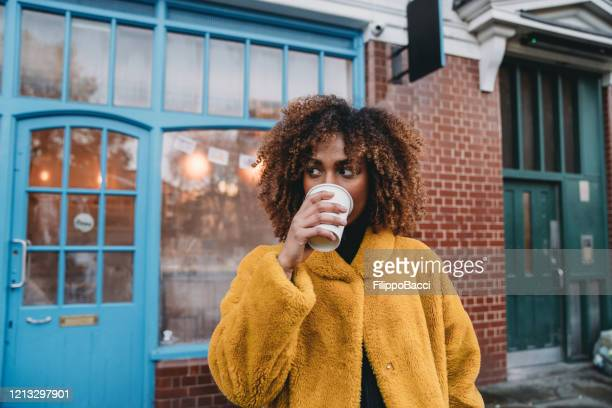 portrait of a young adult beautiful woman drinking coffee - drink stock pictures, royalty-free photos & images