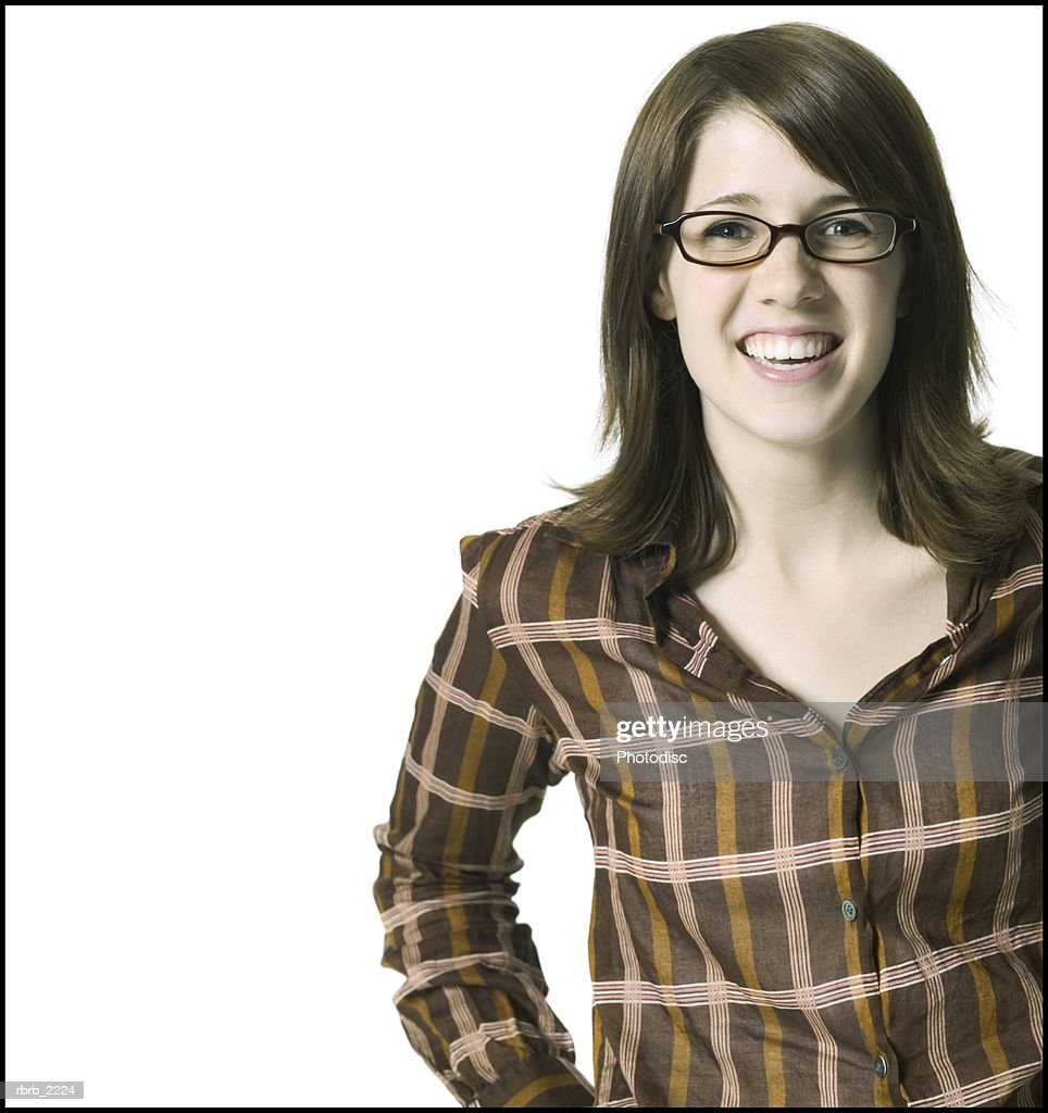 portrait of a young adult female in a striped shirt and glasses as she smiles at the camera : Foto de stock