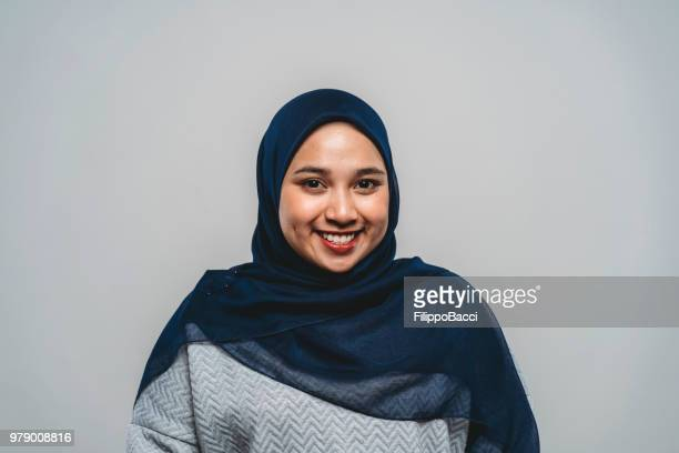 portrait of a young adult malaysian woman - malaysian culture stock pictures, royalty-free photos & images