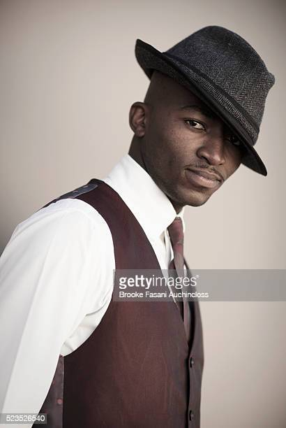 portrait of a young adult man wearing a fedora - fedora stock pictures, royalty-free photos & images