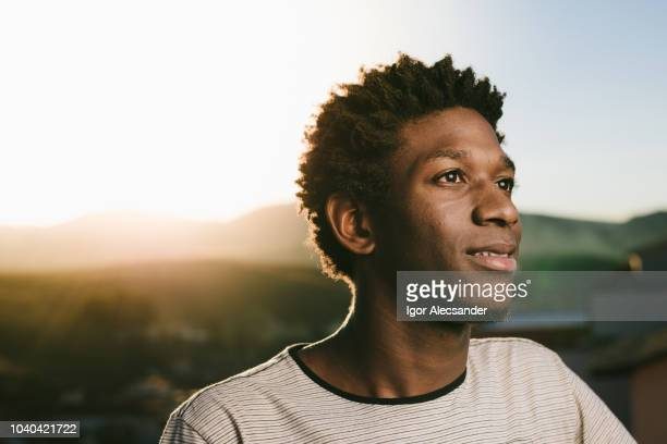 portrait of a young african american - hope stock pictures, royalty-free photos & images
