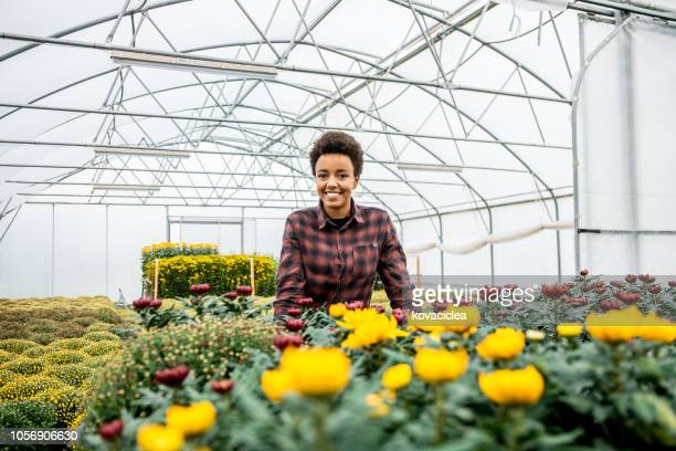 Portrait of a young African woman smiling in the garden center