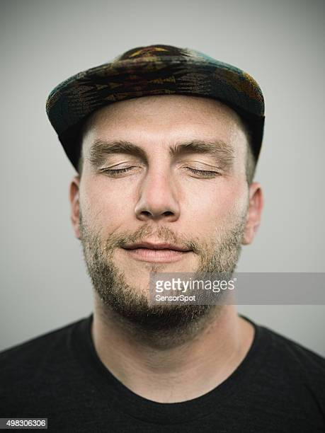 Portrait of a young american man with closed eyes