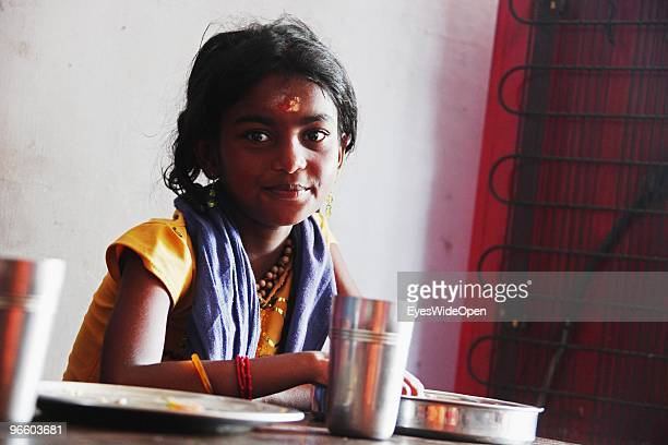 Portrait of a young and pretty indian hindu pilgrim girl with devotional signs on her forehead in a restaurant in Kumily on January 02 2010 in Kumily...