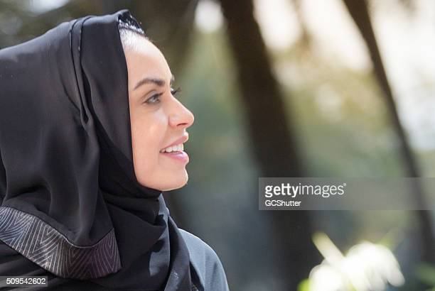 Portrait of a young Arab Woman in a park