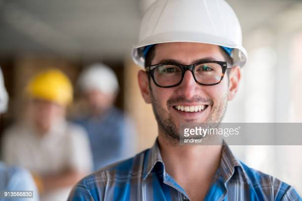 portrait of a young architect at a construction site - council flat stock pictures, royalty-free photos & images