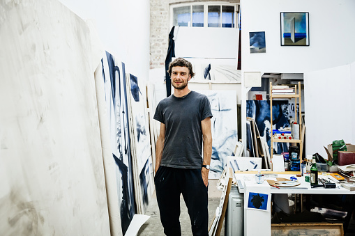Portrait of a young artist standing in his atelier - gettyimageskorea