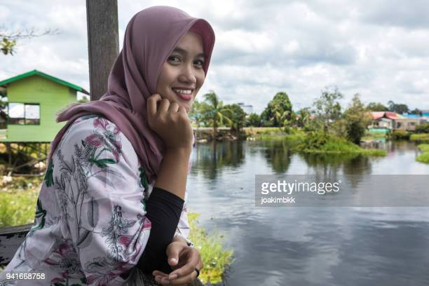 Portrait of a young Asian Muslim girl near a river