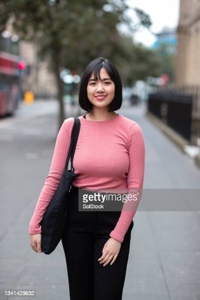 portrait of a young asian woman in the city - ambient light stock pictures, royalty-free photos & images