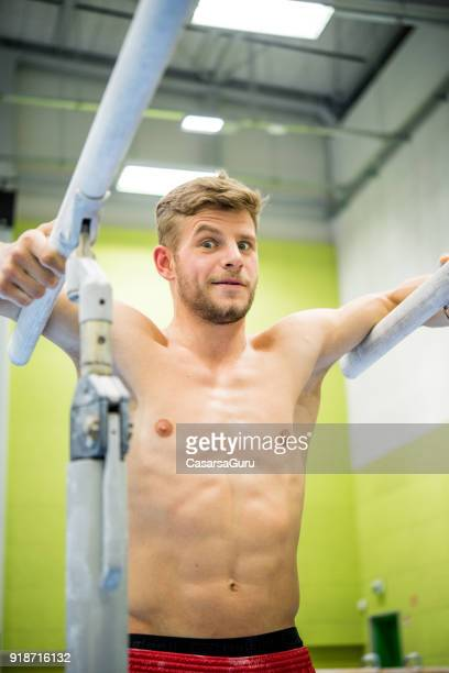 Portrait of a Young Athlete on Parallel Bars