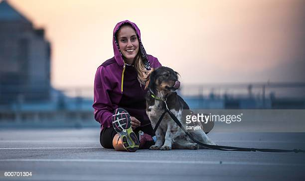 Portrait of a Young Athlete With Her Canine Friend