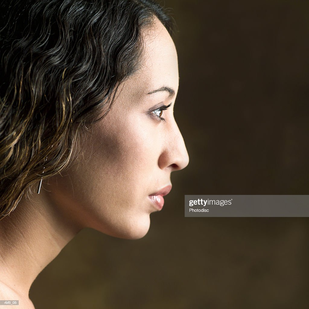 portrait of a young attractive ethnic looking woman shot in profile : Stockfoto