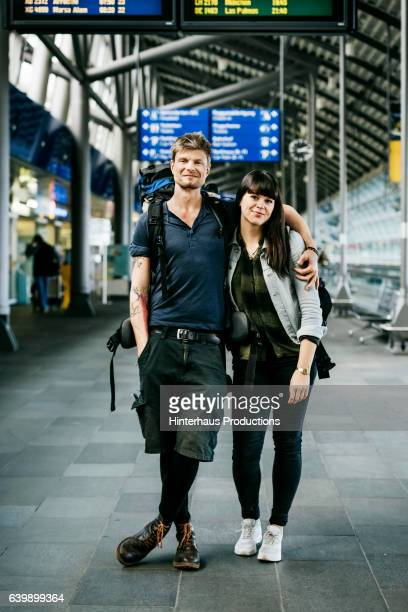 portrait of a young backpacker couple at the airport - travel stock-fotos und bilder