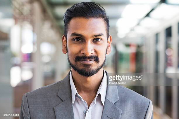 portrait of a young bearded businessman - indian subcontinent ethnicity stock pictures, royalty-free photos & images